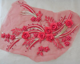 A red & gold threads beaded floral lace applique / red beaded lace motif on tulle is for sale.  sold by per piece