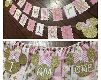 Pink and gold polka dot Minnie Mouse party package which includes a large happy birthday banner and high chair skirt and small banner