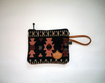 pouch style leather and canvas