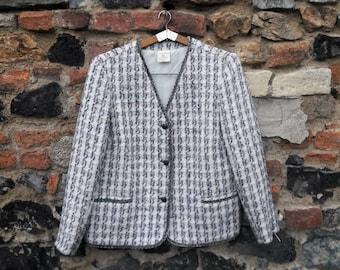 The tartan jacket almost pastel Chanel