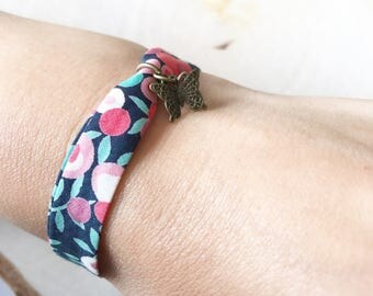 Adjustable bracelet with Liberty Wiltshire red bias and Butterfly charm