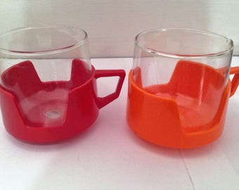 Set of Two Pyrex Vintage Glasses with plastic cup holders, Red and Orange