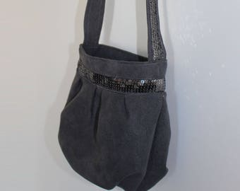 Small purse from gray suede and gunmetal glitter band