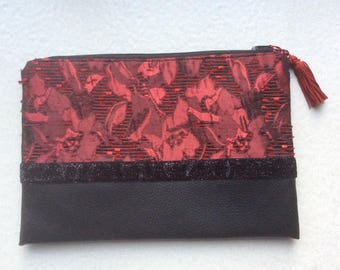 Cute clutch for the holidays. Faux leather and satin Brocade