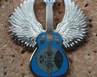 Flying guitar pin