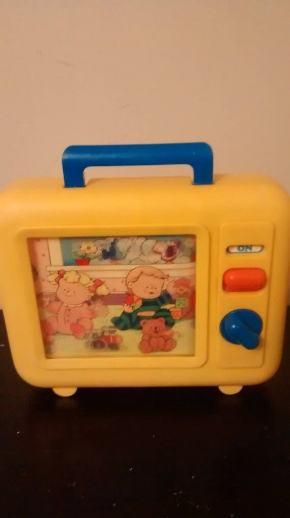 1990s Music Toys : Vintage shelcore wind up tv radio musical toy