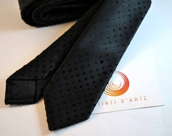Handmade tie for men made up of black fabric and small velvet pois