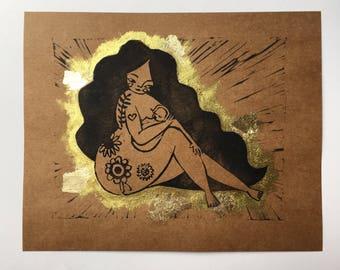 Breastfeeding lino print gold leaf