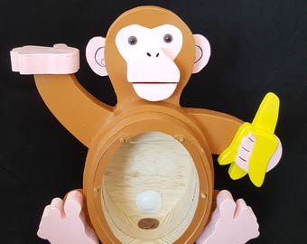 Monkey big belly piggy bank holding a banana