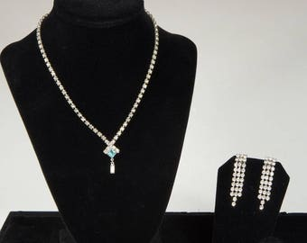 Sparkling vintage rhinestone glamour from the 50's. Spectacular drop earrings and a FREE strand of rhinestones for the neck.