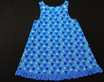 Blue corduroy jumper with hearts and stars