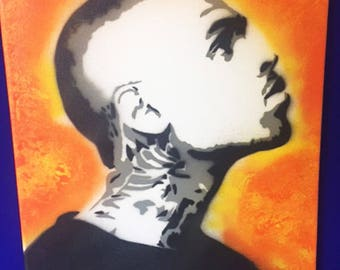 Chris Brown stencil spray painting on canvas. Orange and Yellow.