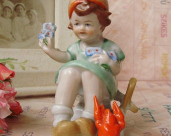 Vintage, German Porcelain child figurine,little girl   with lobster, handpainted
