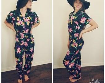80's Black Floral Jumpsuit. Onesie. Cotton. Romper. One piece. Button Front. Elastic Waist. Pockets. Size small.
