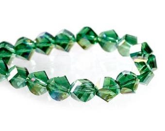 5 Green irregular shaped glass beads faceted