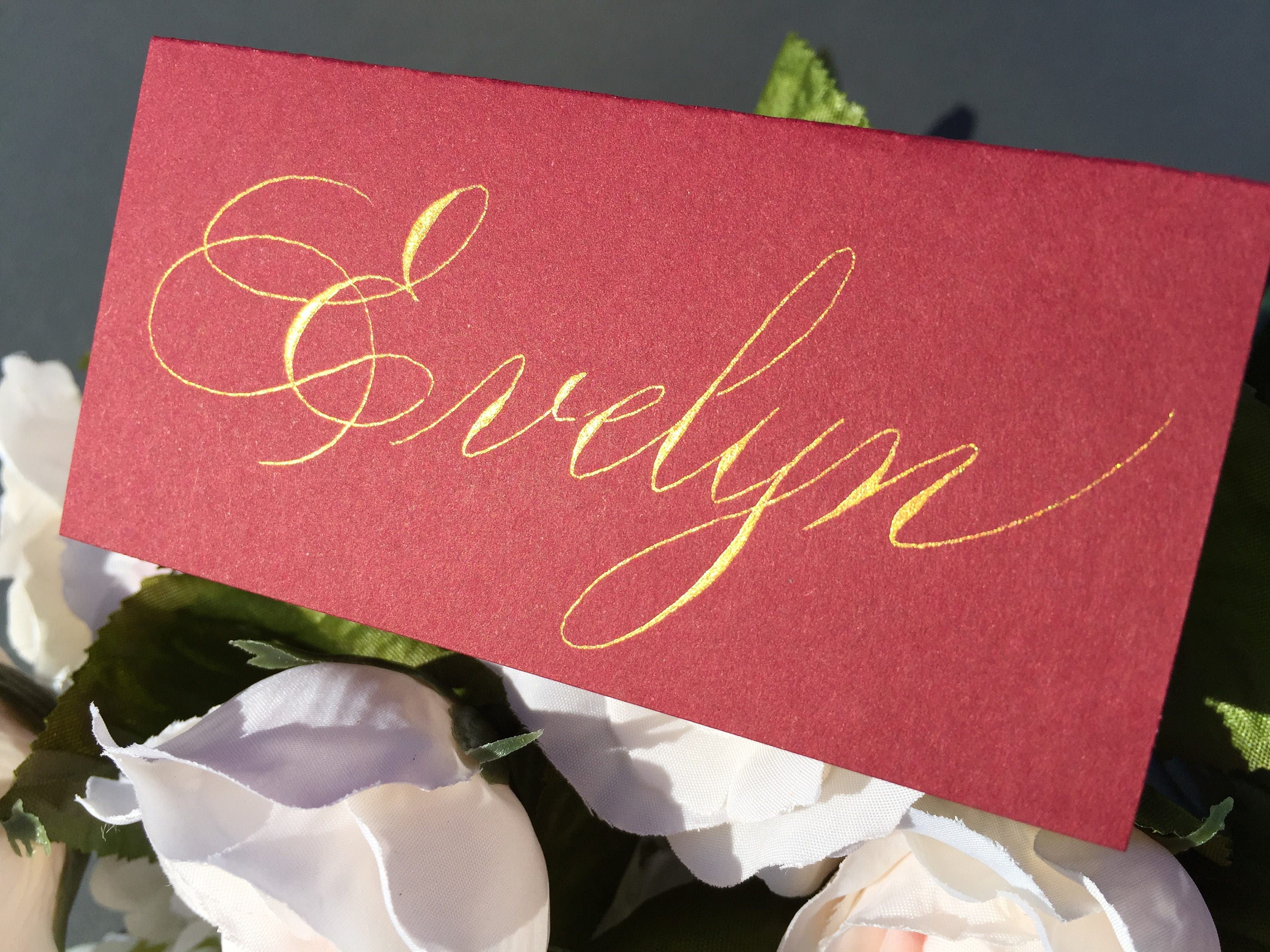 Custom gold writing place cards in red for weddings, dinners ...