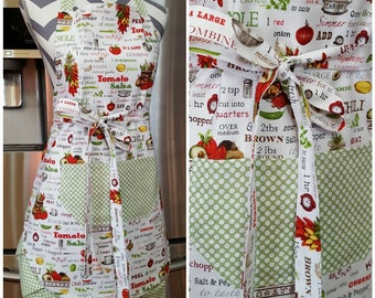 Adult apron. Woman's apron. Bright salsa recipe with green and white polka dot pocket, ties and frills.
