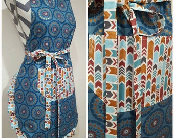 Adult apron. Woman's apron. Gorgeous blues/teals/rose gold colors in circle pattern main. Same colors on arrows on pocket ties & frills.