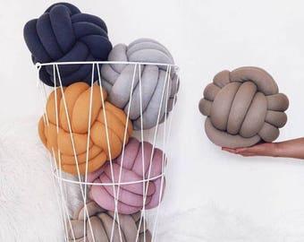 3 navy knot pillows