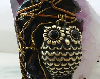 Night owl obsidian arrowhead wire wrapped pendant.