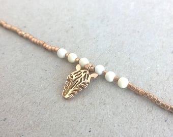 Zebra and delicate beaded bracelet