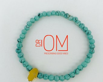 turquoise magnesite beaded bracelet with 22 k matte gold hamsa accent bead, hamsa bracelet,yoga bracelet