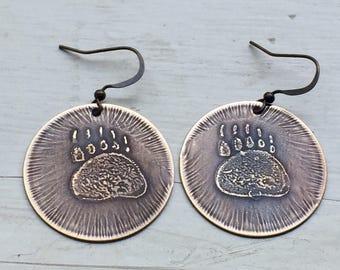 etched brass bear paw earrings