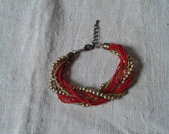 nice bracelet red and gold beads