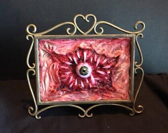 Toothy gore framed art