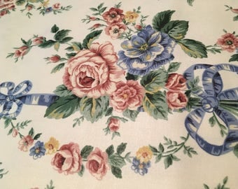Vintage - Regency collection  by Ambiance. Burgundy rose with blue ribbon print on medium weight medium sheen cotton