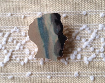 Brooch of vintage jigsaw piece