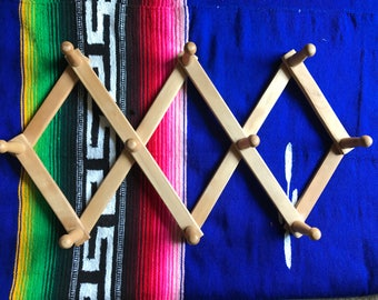 Accordian peg  rack