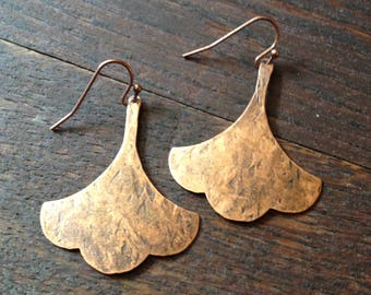 Rustic abstract copper earrings on copper earwires.