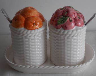 Summer sale.............A set of preserve pots on a stand.