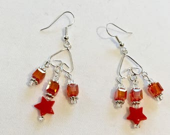 Bright red star dangly earrings