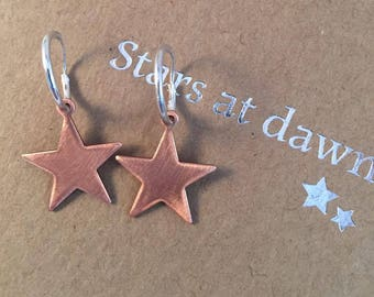 Rose gold copper star earrings set on delicate sterling silver creole hoops