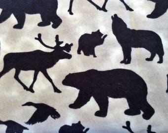 25 inches of Flannel/Dark brown wilderness animal silhouettes on tan-beige background cotton fabric