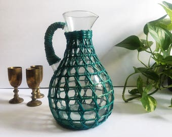 Vintage Glass Pitcher with Green Rattan
