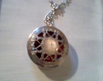 round Locket with rose filigree pendant