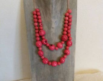 Ethnic necklace with tagua and acai seeds pink