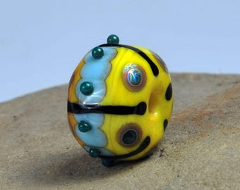 Yellow patterned bead