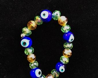 Beaded evil eye bracelet with gold glass beads