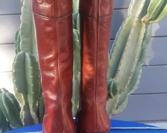 Butter soft deep burgundy/rust tall leather boots from 1970's. Made in Italy size 9