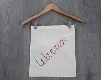 Tote bag embroidered in blue and Red Warrior