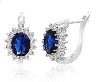 White Sapphire Sorrounding Oval Center Blue Sapphire Lever Back Earring in 18K White Gold