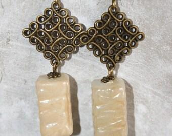 Earrings dangle beads with charms