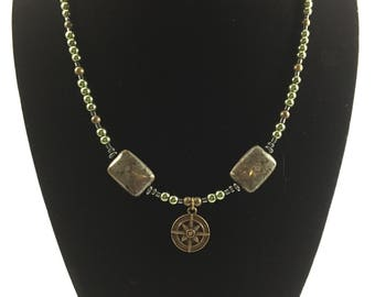 Beaded green and bronze compass necklace