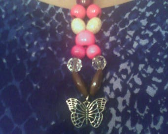 Beaded necklace with pink, dark red, and crystal beads with butterfly charm