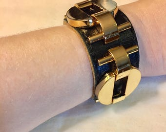 Vintage CC Skye Black Leather Cuff With Bold Gold Metal Embellishments