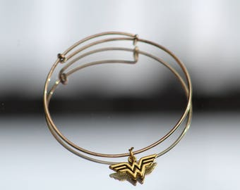 Gold Plated Cross-Wire Bracelet with Wonder Woman Charm